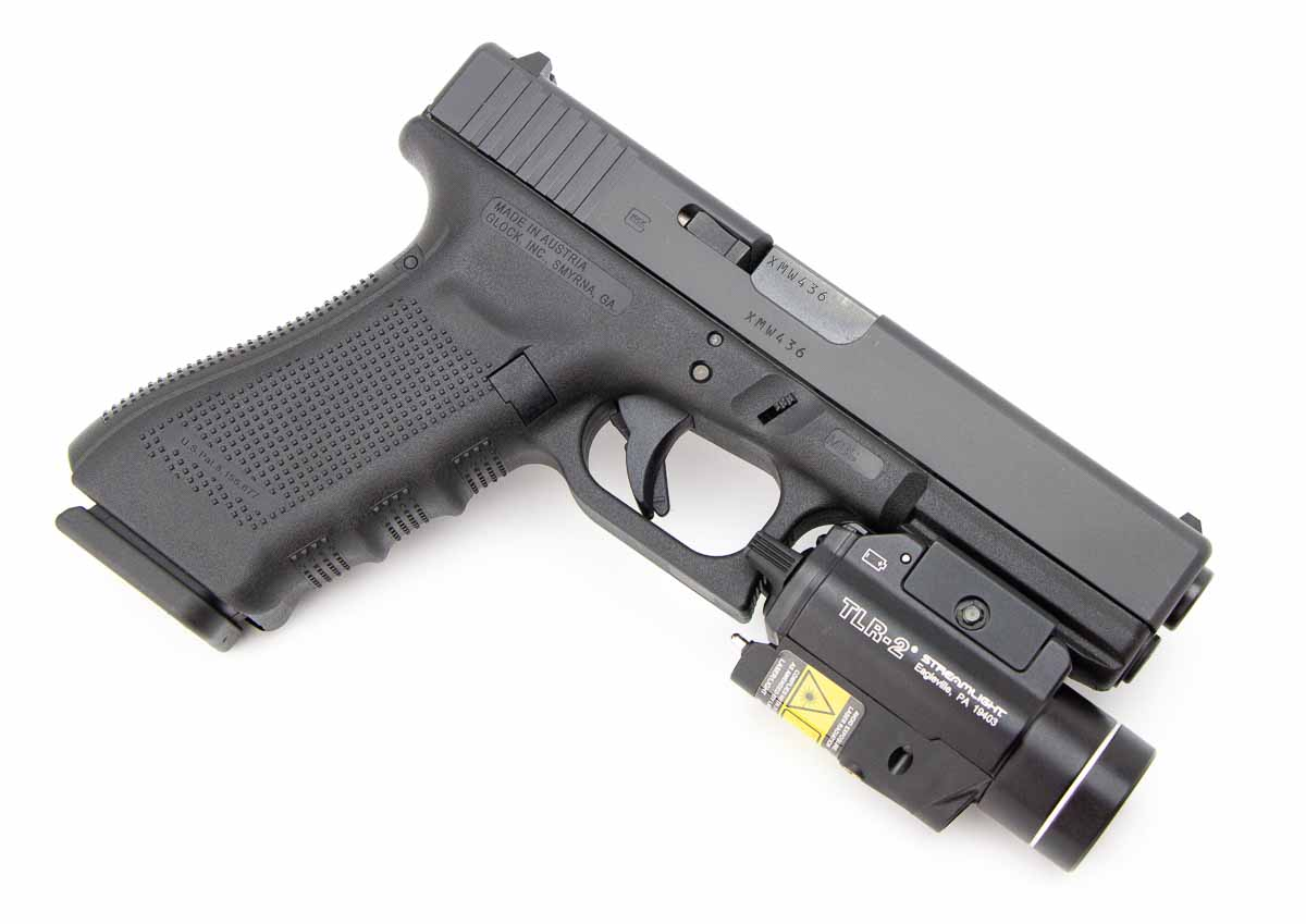 Glock pistol with weapon light attached