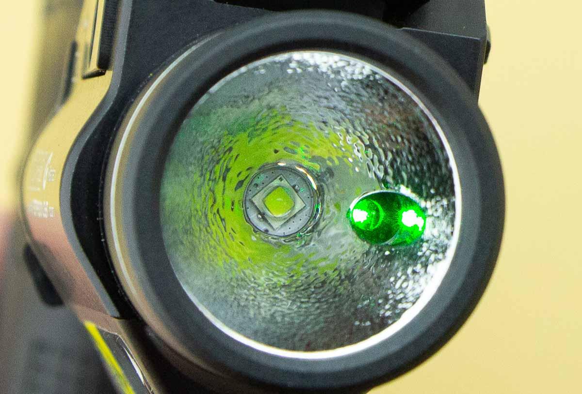 green laser emitter next to the light LED