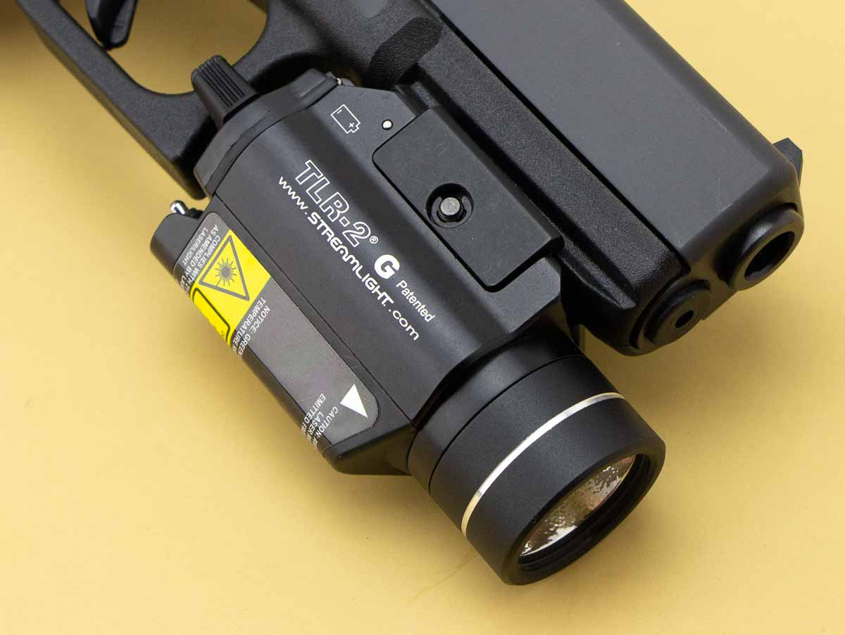 how far does the TLR-2 stick out past the muzzle