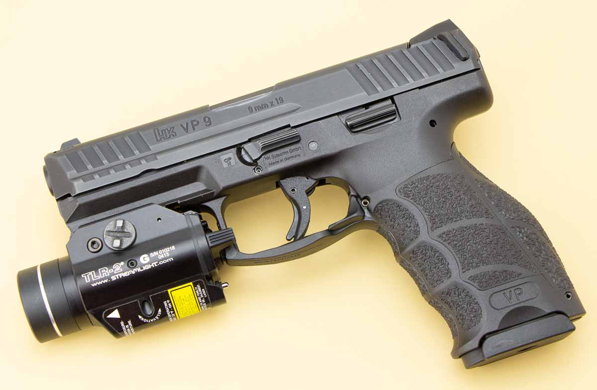 shooting a pistol with a streamlight weapon light attached