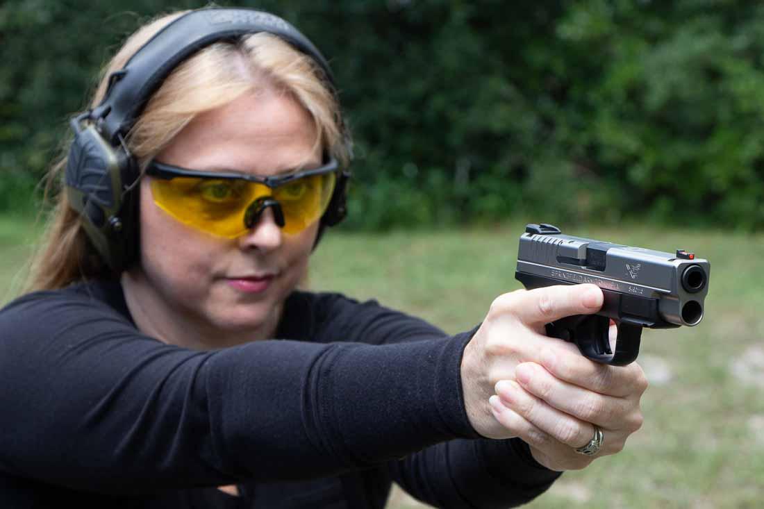 Beautiful woman shooting the XDS 4.0