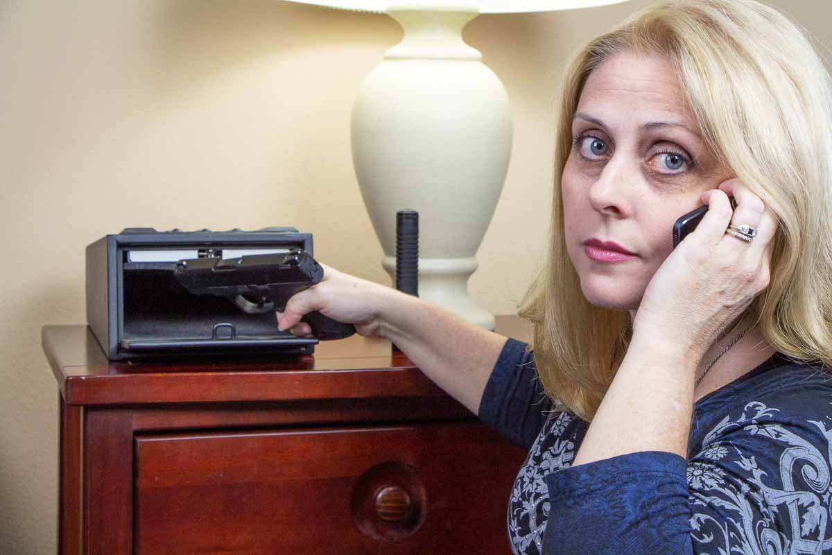 beautiful blonde woman with 9mm pistol for self defense