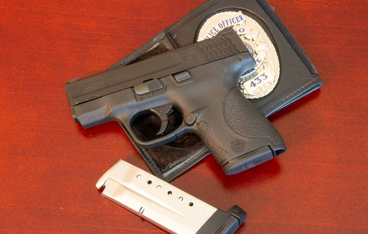 concealed carry pistol from Smith and Wesson with police badge