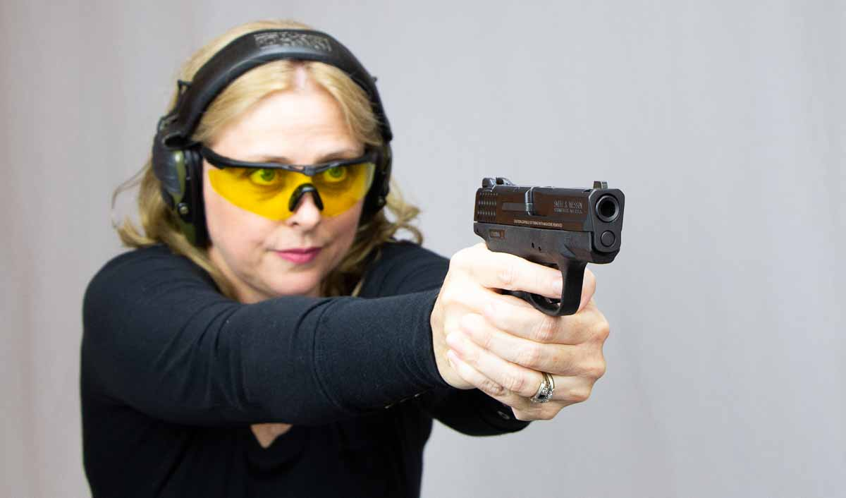 sexy woman concealed carry self defense with 9mm pistol