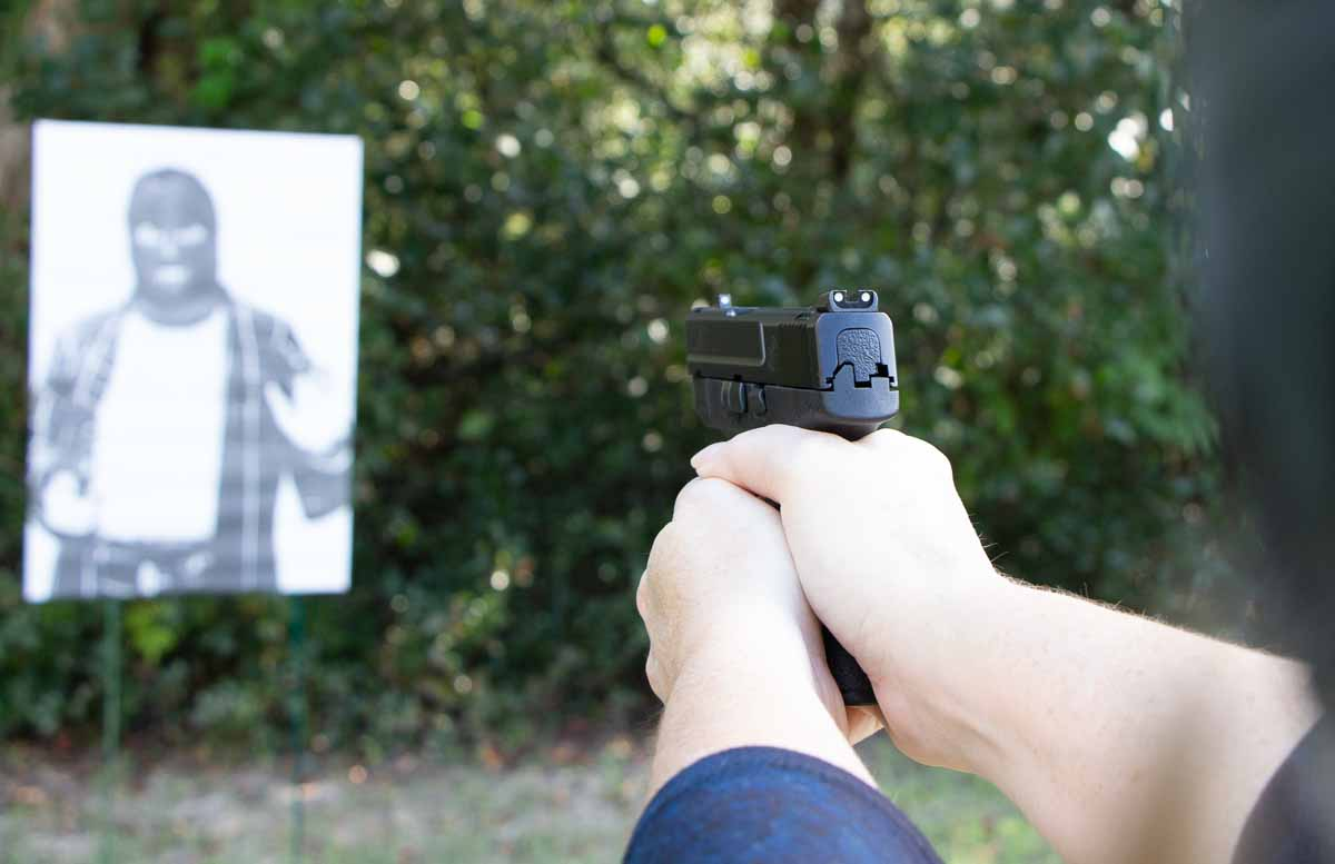 woman testing the smith and wesson shield pistol