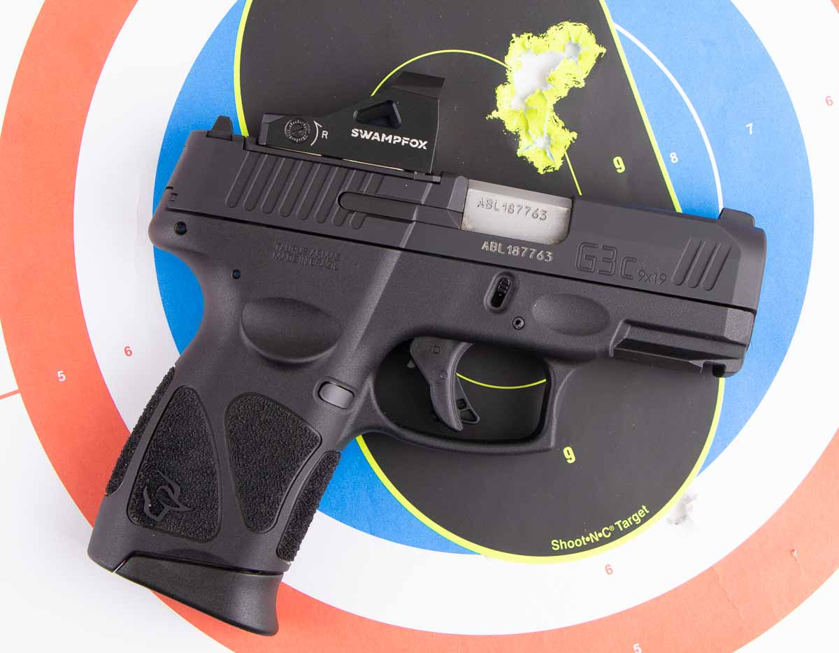 range testing the Taurus G3c 9mm pistol with a red dot sight